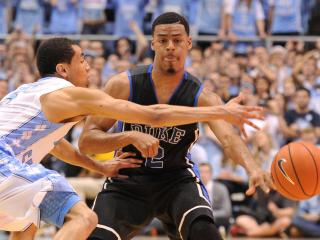 Quinn Cook (2) completes a pass during action at the Dean E. Smith Center between the North Carolina Tar Heels and the Duke Blue Devils on February 20, 2014 in Chapel Hill, NC. (Will Bratton/WRAL contributor)