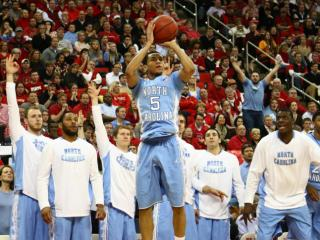The UNC bench watches as Marcus Paige (5) fires a three pointer. NC State lost to UNC in overtime, 85-84, on February 26, 2014 at the PNC arena in Raleigh, North Carolina. Photo by: Jerome Carpenter