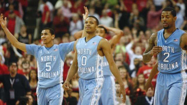 The Tar Heels react to a foul that sent T.J. Warren (24) to the line for the game tying free throws. NC State lost to UNC in overtime, 85-84, on February 26, 2014 at the PNC arena in Raleigh, North Carolina. Photo by: Jerome Carpenter