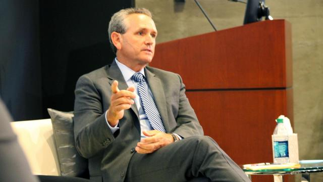 """""""If you want to be a professional, be a professional,"""" UNC athletic director Bubba Cunningham said during a discussion of whether student-athletes should be compensated."""