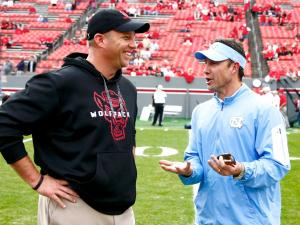 Coaches Dave Doeren and Larry Fedora chat before the game. North Carolina defeated NC State by a score of 45-34 on November 28, 2015 at Carter-Finley Stadium in Raleigh, North Carolina.  (Photo by: Jerome Carpenter/Wral Contributor)