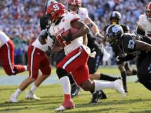 NC State nearly watched a big fourth-quarter lead disappear Friday in Chapel Hill, but the Wolfpack was able to hold on for a 28-21 win over rival North Carolina. The win was No. 6 on the year for NC State, making them bowl eligible for the third consecutive season under head coach Dave Doeren.