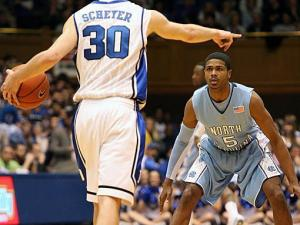 UNC's Dexter Strickland locks in on Duke's Jon Scheyer early in UNC's 82-50 road loss in Durham on Saturday (Photo by Jack Morton).
