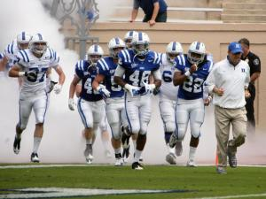 Duke coach David Cutcliffe (right) and his Blue Devil football team take the field at Wallace Wade Stadium for the 2012 spring football game on Saturday, March 31, 2012 in Durham, N.C. (Photo by Jack Morton).