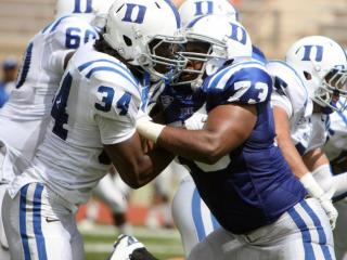 Duke's Jonathan Woodruff (34) and Takoby Cofield (73) during the 2012 spring football game at Wallace Wade Stadium on Saturday, March 31, 2012 in Durham, N.C. (Photo by Jack Morton).