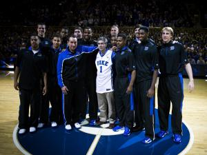Coach Mike Krzyzewski and the Duke basketball team honor the special guest of the night.