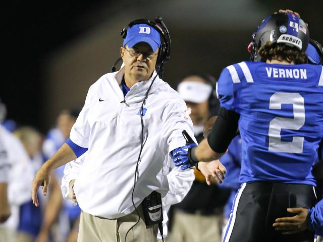 Duke's #2 Conner Vernon is congratulated by coach Cutcliffe as Duke comes back to defeat UNC 33 to 30 Saturday night October 20, 2012. (Photo by Jack Tarr)