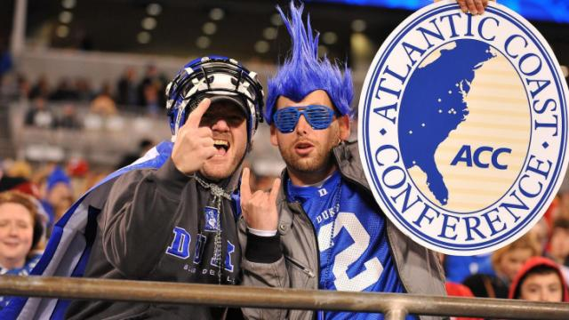 Fans of the Duke Blue Devils pose for a photo during a game against the Cincinnati Bearcats during the Belk Bowl at Bank of America Stadium on December 27, 2012 in Charlotte, North Carolina. (Photo by Lance King)