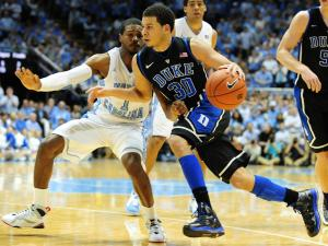 Seth Curry (30) drives past a defender during the North Carolina Tar Heels vs. Duke Blue Devils NCAA basketball game, Saturday, March 9, 2013 in Chapel Hill, NC.