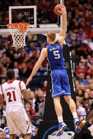 Mason Plumlee #5 of the Duke Blue Devils goes up for a dunk against Chane Behanan #21 of the Louisville Cardinals during the Midwest Regional Final of the 2013 NCAA Men's Basketball Tournament at Lucas Oil Stadium on March 31, 2013 in Indianapolis, IN. Louisville defeated Duke 85-63. (Photo by Lance King)