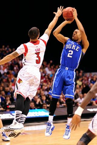 Quinn Cook #2 of the Duke Blue Devils puts up a shot against Peyton Siva #3 of the Louisville Cardinals during the Midwest Regional Final of the 2013 NCAA Men's Basketball Tournament at Lucas Oil Stadium on March 31, 2013 in Indianapolis, IN. Louisville defeated Duke 85-63. (Photo by Lance King)