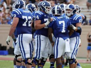 Duke celebrates an Anthony Boone touchdown plunge during the Blue Devils' 45-0 victory over neighbor NC Central on Saturday, August 31, 2013 in Durham, NC (Photo by Jack Morton).