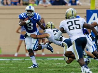 Duke running back Josh Snead (9) runs the ball. Pitt defeats Duke 58 to 55 at Wallace Wade Stadium Saturday September 21, 2013(photo by Jack Tarr 2013)
