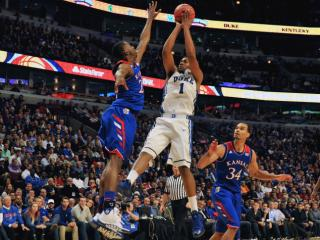Duke Blue Devils forward Jabari Parker (1) puts up a shot against Kansas Jayhawks guard Andrew Wiggins (22) during the State Farm Champions Classic at the United Center on November 12, 2013 in Chicago, Illinois. Kansas defeated Duke 94-83. (Photo by: Lance King)