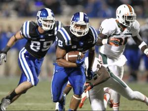 Shaquille Powell (28) breaks free for Duke. The Miami Hurricanes face Duke at Wallace-Wade Stadium for a showdown of the 7-2 ACC teams. Duke shocks the Canes with a 48 to 30 victory. Photo by CHRIS BAIRD