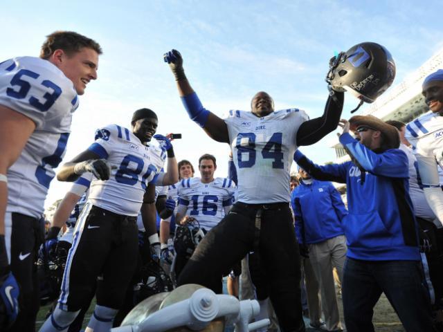 Kenny Anunike (84) celebrates following action at Kenan Stadium between the University of North Carolina Tar Heels and the Duke University Blue Devils on November 30, 2013 in Chapel Hill, NC.