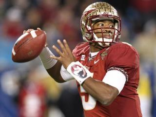Florida State Seminoles quarterback Jameis Winston (5) looks downfield. Florida State and Duke University face each other in the ACC Football Championship on December 7, 2013 at Bank of America Stadium. Photo by CHRIS BAIRD