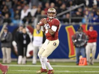 Florida State Seminoles quarterback Jameis Winston (5) looks for an open man. Florida State and Duke University face each other in the ACC Football Championship on December 7, 2013 at Bank of America Stadium. Duke could not keep pace with Florida State's offense falling by a score of 45 to 7. Photo by CHRIS BAIRD