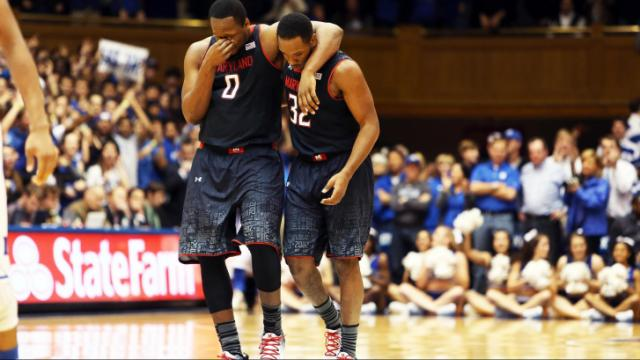 Maryland's Charles Mitchell (left) and Dez Wells late during the Terrapins' game at Duke on Saturday, February 15, 2014 in Durham, NC.  Duke defeated the Terrapins 69-67.  (Photo by Jack Morton)