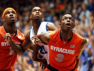 Duke's Amile Jefferson (center) during the Blue Devils' game versus Syracuse on Saturday, February 22, 2014 in Durham, NC.  Duke defeated the Orange 66-60.  (Photo by Jack Morton)
