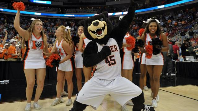 Cheerleaders and the mascot of the Mercer Bears celebrate following their victory over the Duke Blue Devils during the second round of the 2014 NCAA Men's Basketball Tournament at PNC Arena on March 21, 2014 in Raleigh, NC. The Mercer Bears defeated the Duke Blue Devils 78-71. (Lance King/WRAL contributor)