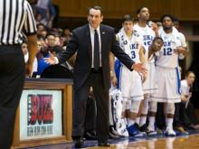 The Blue Devils defeated coach Mike Krzyzewski's college team 93-73 Sunday.