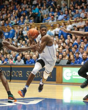 Amile Jefferson (21) of the Duke Blue Devils. After a slow start Duke put the hammer down in the second half sending Miami back home with a road loss. Duke won by a score of 70 to 58 victory. (Chris Baird / WRAL Contributor).