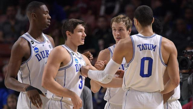 Harry Giles (1), Grayson Allen (3), Luke Kennard (5), Matt Jones (13) and Jayson Tatum (0) of the Duke Blue Devils huddle during their game against the Troy Trojans during the first round of the 2017 NCAA Men's Basketball Tournament at Bon Secours Wellness Arena on March 17, 2017 in Greenville, South Carolina. (Lance King/WRAL contributor)