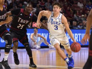Grayson Allen (3) of the Duke Blue Devils drives against DeVon Walker (25) of the Troy Trojans during the first round of the 2017 NCAA Men's Basketball Tournament at Bon Secours Wellness Arena on March 17, 2017 in Greenville, South Carolina. (Lance King/WRAL contributor)