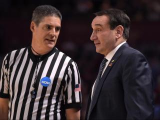 Head coach Mike Krzyzewski of the Duke Blue Devils listens to a referee during the game against the South Carolina Gamecocks during the second round of the 2017 NCAA Men's Basketball Tournament at Bon Secours Wellness Arena on March 19, 2017 in Greenville, South Carolina. (Lance King/WRAL contributor)