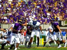 East Carolina quarterback Dominique Davis heaved a 33-yard touchdown pass to a leaping Justin Jones as time expired to give the Pirates a wild 51-49 win against Tulsa on Sunday in coach Ruffin McNeill's debut at his alma mater.