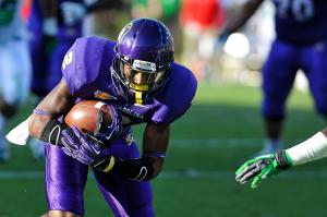 East Carolina Pirates wide receiver Justin Hardy (2)  runs the ball during todays game.East Carolina defeats Marshall  65-59 in O.T. at Dowdy-Ficklen Stadium in Greenville North Carolina. (Photos By Anthony Barham)