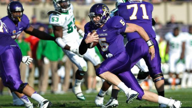 East Carolina Pirates quarterback Shane Carden (5)  keeps the ball during todays game.East Carolina defeats Marshall  65-59 in O.T. at Dowdy-Ficklen Stadium in Greenville North Carolina. (Photos By Anthony Barham)