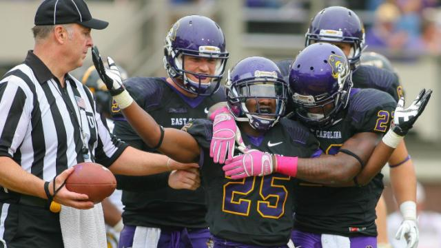 East Carolina Pirates running back Breon Allen (25) celebrates after scoring an ECU touchdown during todays game. East Carolina defeats Southern Miss 55-14 on Saturday, October 19, 2013 in Greenville, NC (Photos By Anthony Barham)