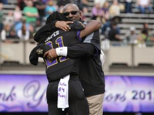 East Carolina Pirates head coach Ruffin McNeill and East Carolina Pirates running back Vintavious Cooper (21) during todays game. East Carolina defeats UAB Blazers 63-14 on Saturday, November 16, 2013 in Greenville, NC (Photos By Anthony Barham)