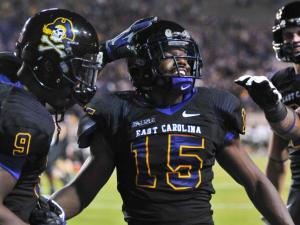 East Carolina Pirates wide receiver Reese Wiggins (15) celebrates after scoring during todays game. East Carolina defeats UAB Blazers 63-14 on Saturday, November 16, 2013 in Greenville, NC (Photos By Anthony Barham)