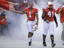 N.C. State and North Carolina hired new football coaches this season. On Saturday, Nov. 10, 2007, they met for the first time in a game that gave new life to a rivalry that stretches over the decades.