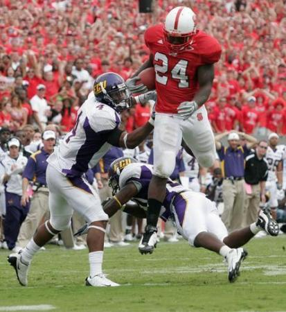 Andre Brown of N.C. State hurdles East Carolina defenders during overtime on September 20, 2008.