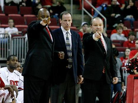 N.C. State coaches Sidney Lowe, Pete Strickland and Monte Towe on February 3, 2009.