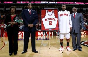 N.C. State senior Simon Harris stands with his parents and head coach Sidney Lowe as he is honored on Senior Night at the RBC Center on March 4, 2009.