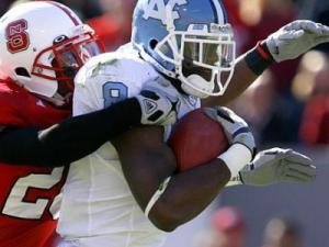 Greg Little of North Carolina is tackled by C.J. Wilson of N.C. State on November 28, 2009.