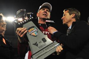 Tom O'Brien accepts the Champs Sports Bowl trophy following the North Carolina State Wolfpack vs. West Virginia Mountaineers game, Tuesday, December 28, 2010 at the Champs Sports Bowl in Orlando, FL.