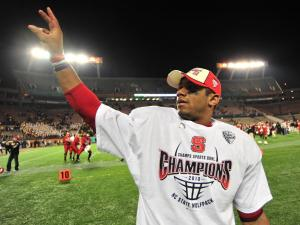 Russell Wilson (16) celebrates following the North Carolina State Wolfpack vs. West Virginia Mountaineers game, Tuesday, December 28, 2010 at the Champs Sports Bowl in Orlando, FL.