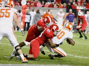 Art Norman (95) and T.Y. McGill(75) team up to sack Tajh Boyd (10) during the Clemson vs. NC State game on November 19, 2011 in Raleigh, North Carolina.