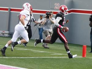Manny Stocker (16) only needs one shoe to find the endzone during the NC State Kay Yow 2012 Spring Football Game in Raleigh, NC on April 21, 2012.