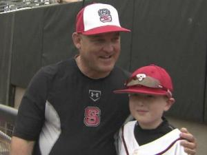 Harrison McKinion poses with NC State baseball head coach Elliot Avent during batting practice.