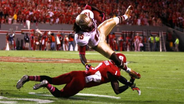 David Amerson (1) upends Greg Dent (15) during the Florida State vs. NC State game on October 6, 2012 in Raleigh, North Carolina.