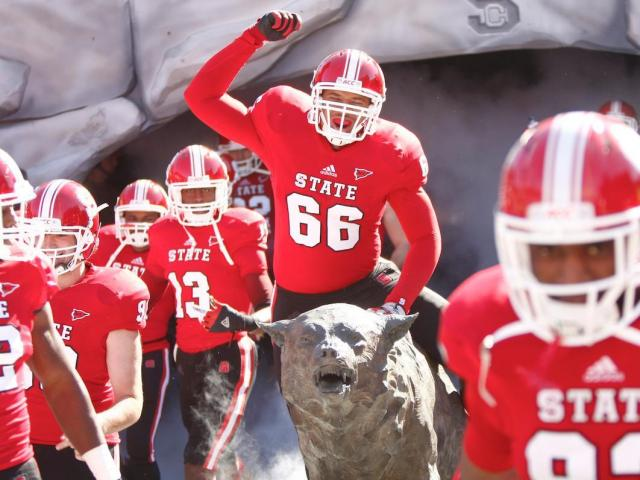 Quincey McKinney rides the wolf before the start of the Virginia vs. NC State game on November 3, 2012 in Raleigh, North Carolina.<br/>Photographer: Jerome Carpenter