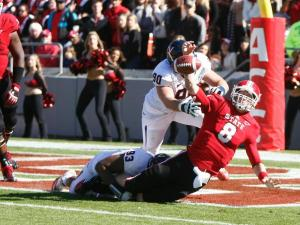 Will Hill (93) brings down Mike Glennon (8) for a safety during the Virginia vs. NC State game on November 3, 2012 in Raleigh, North Carolina.