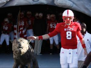 Mike Glennon pats the wolf for good luck before the Wake Forest vs. NC State game on November 10, 2012 in Raleigh, North Carolina.